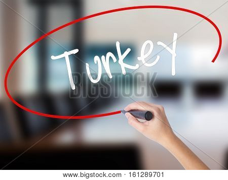 Woman Hand Writing Turkey  With A Marker Over Transparent Board