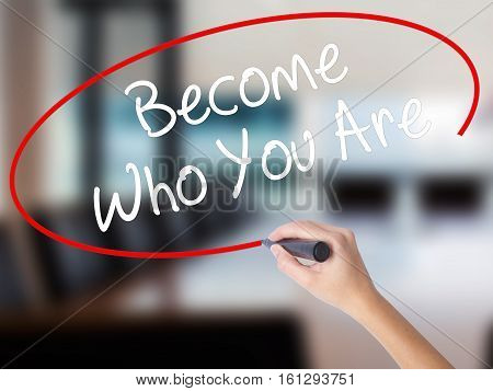 Woman Hand Writing Become Who You Are With A Marker Over Transparent Board