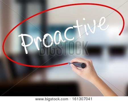 Woman Hand Writing Proactive With A Marker Over Transparent Board.