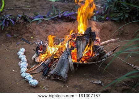 Fire flames for barbecue potatoes, Pondichery India