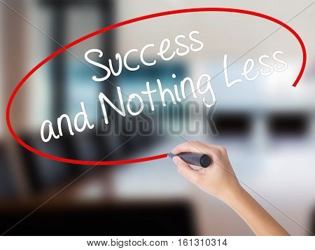 Woman Hand Writing Success And Nothing Less With A Marker Over Transparent Board