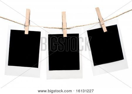 Three blank instant photos hanging on the clothesline