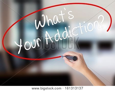 Woman Hand Writing What's Your Addiction? With A Marker Over Transparent Board