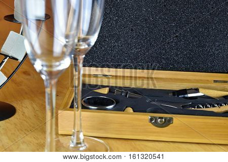 Set of wine in a wooden box. Two glasses of wine.