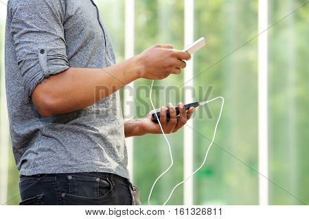 Man Holding External Battery And Smart Phone