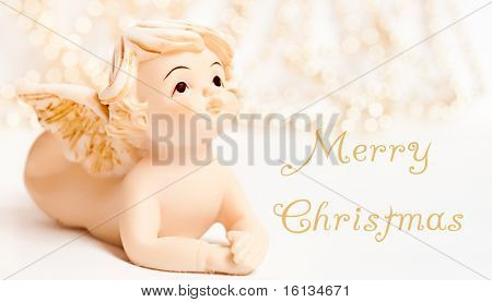 angel christmas ornament. little ceramic angel on christmas background