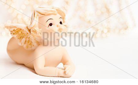 angel christmas ornament. little ceramic angel on christmas background