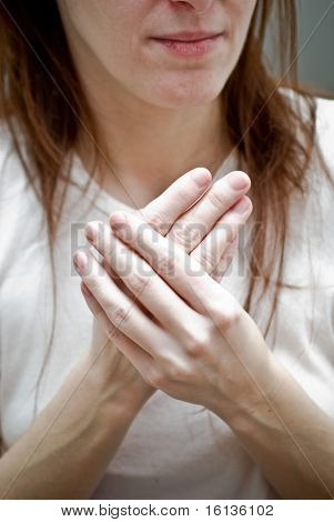 Woman rubbing her hands