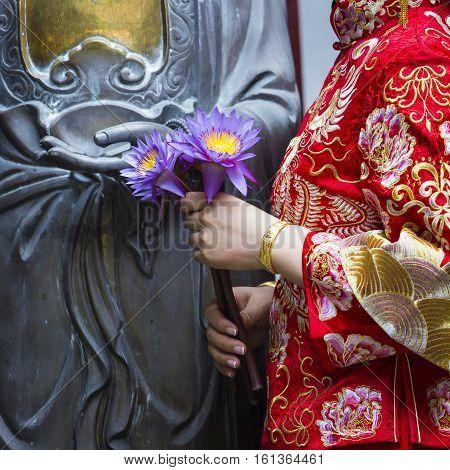 Woman Hand Respect To Buddha Statue.