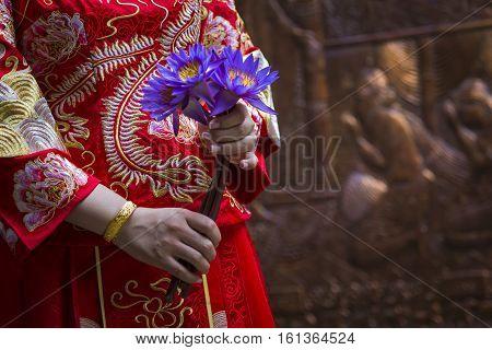 Woman hand respect to buddha statue, Sri Lanka