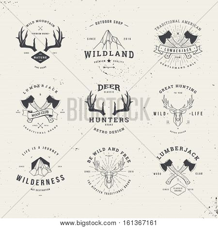 wildlife hunters hipster logo set with deer antlers axe and mountains