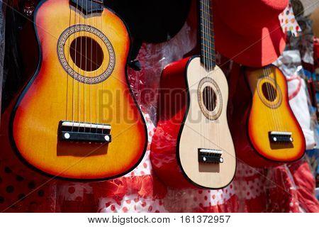 Seville souvenir spanish guitar in Plaza Espana of Sevilla Andalusia Spain