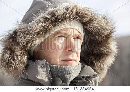 The Guy's Portrait In A Hood In The Winter