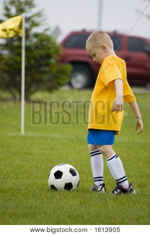 Young Boy Enjoying A Soccer Game