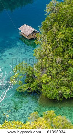 Bamboo Hut in Mangrove near Warikaf Homestay, Kabui Bay and Passage. Gam Island, West Papuan, Raja Ampat, Indonesia. Without reflection.