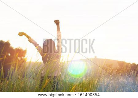 Silhouette Of Young Woman Standing At Relax Pose Or Freedom Pose Or Chill Pose On The Meadow During