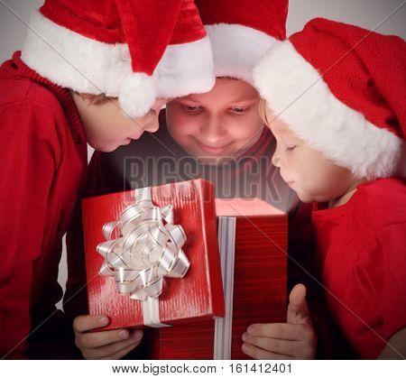 3 happy boy open christmas gift-box