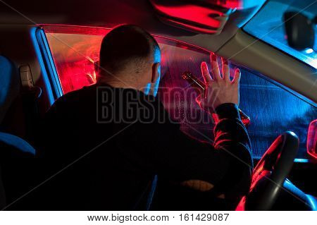 Male Drunk Driver Sitting In His Car