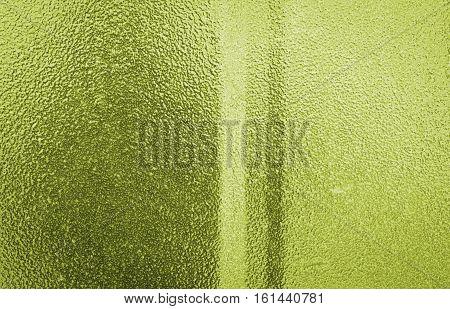 Metal, metal background, metal texture.Lemon-colored metal texture, lemon-colored metal background. Abstract metal background.