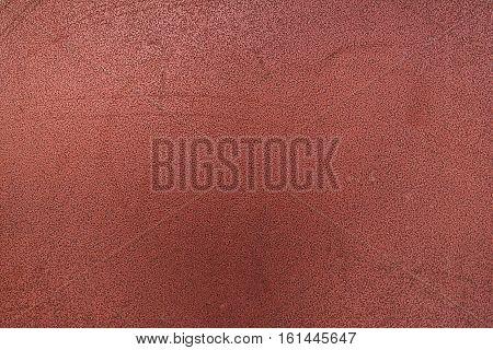 Metal, metal background, metal texture. Dark red metal texture, dark red metal background. Abstract metal background.