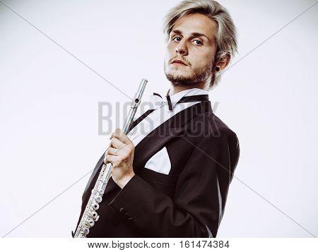 Male Flutist Wearing Tailcoat Holds Flute