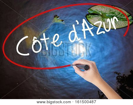 Woman Hand Writing Cote D'azur With Marker Over Transparent Board