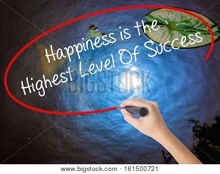 Woman Hand Writing Happiness Is The Highest Level Of Success With Marker Over Transparent Board