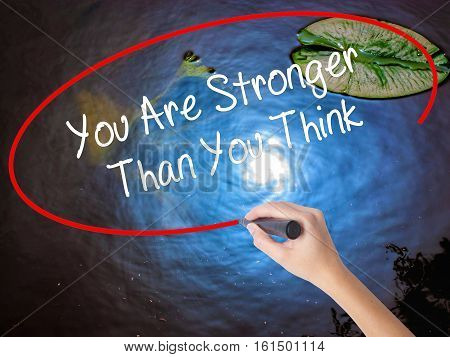 Woman Hand Writing You Are Stronger Than You Think With Marker Over Transparent Board