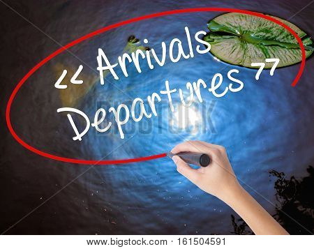 Woman Hand Writing Arrivals - Departures With Marker Over Transparent Board.