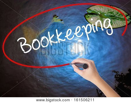 Woman Hand Writing Bookkeeping With Marker Over Transparent Board.
