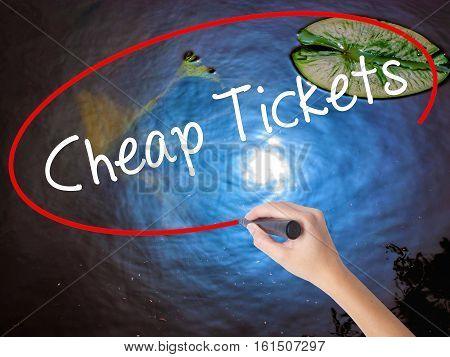 Woman Hand Writing Cheap Tickets With Marker Over Transparent Board
