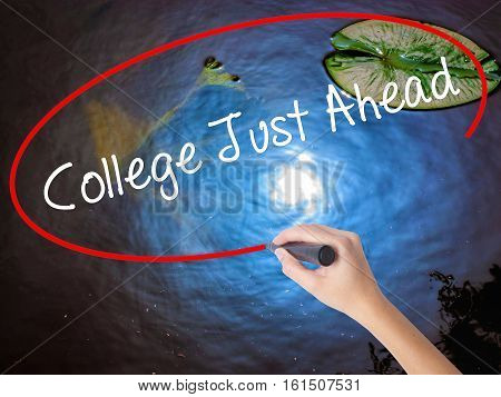 Woman Hand Writing College Just Ahead  With Marker Over Transparent Board