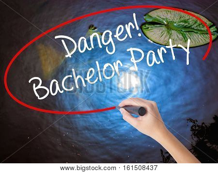 Woman Hand Writing Danger! Bachelor Party With Marker Over Transparent Board