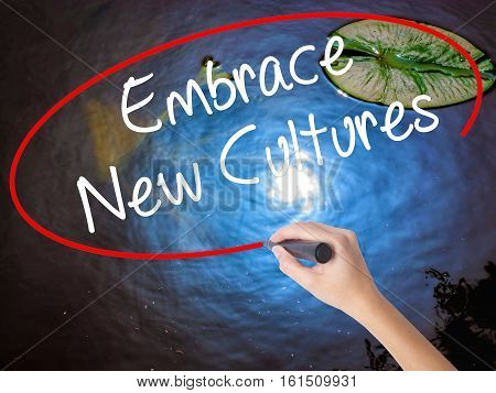 Woman Hand Writing Embrace New Cultures With Marker Over Transparent Board