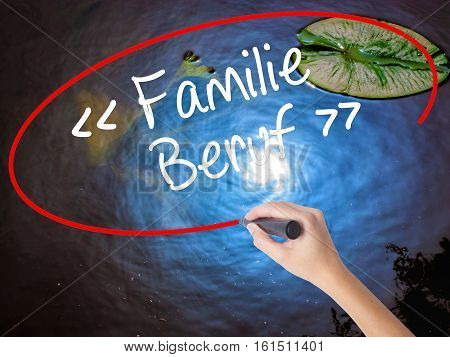 Woman Hand Writing Familie Beruf (family Occupation In German) With Marker Over Transparent Board