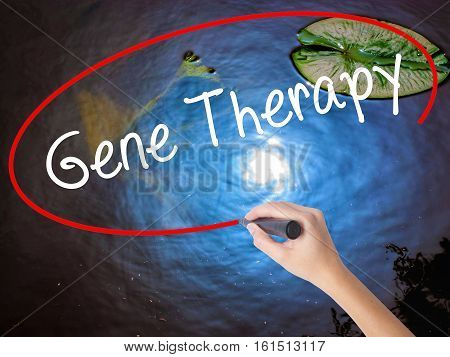 Woman Hand Writing  Gene Therapy  With Marker Over Transparent Board