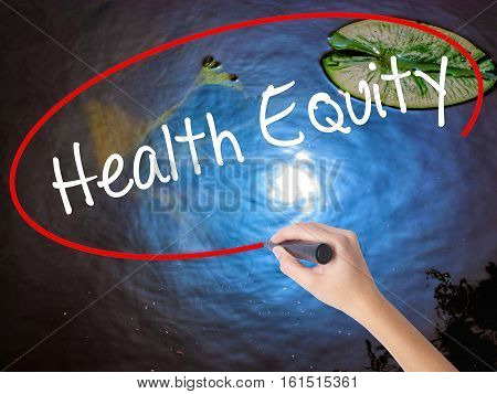 Woman Hand Writing Health Equityt With Marker Over Transparent Board