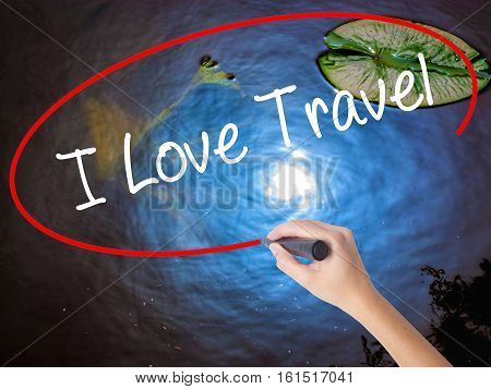 Woman Hand Writing I Love Travel With Marker Over Transparent Board