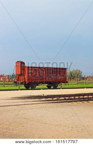Oswiecim, Poland - May 2, 2014: Wagon on Rail track of Auschwitz Birkenau concentration camp Poland.