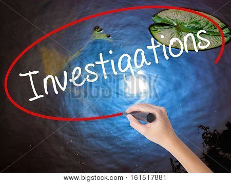 Woman Hand Writing Investigations With Marker Over Transparent Board.
