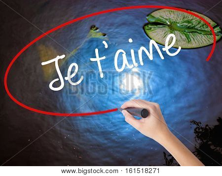 Woman Hand Writing Je T'aime ( I Love You In French)  With Marker Over Transparent Board