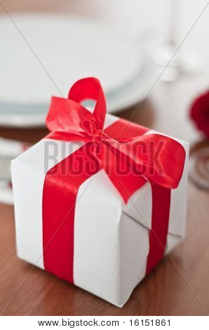 Romantic Dinner.Place setting for Valentine's Day with valentines gift box