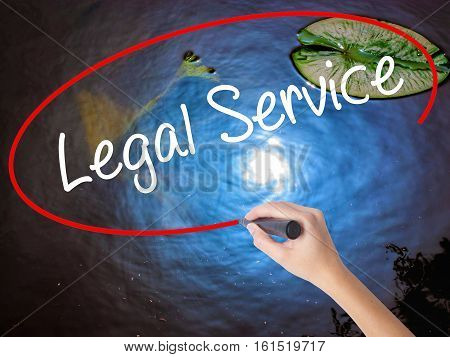 Woman Hand Writing Legal Service With Marker Over Transparent Board