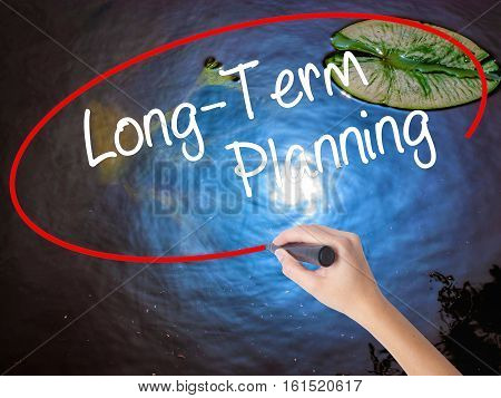 Woman Hand Writing  Long-term Planning With Marker Over Transparent Board