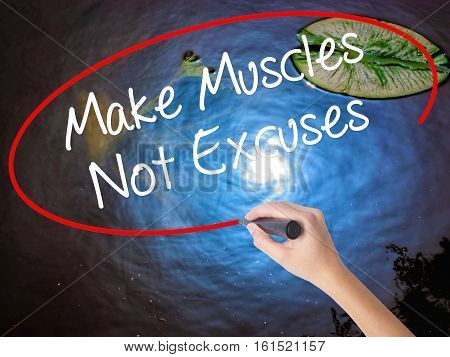Woman Hand Writing Make Muscles Not Excuses With Marker Over Transparent Board
