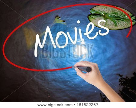 Woman Hand Writing  Movies With Marker Over Transparent Board