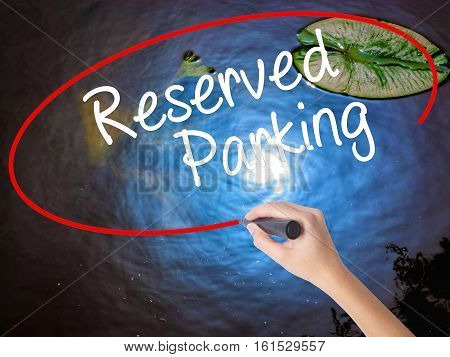 Woman Hand Writing Reserved Parking With Marker Over Transparent Board