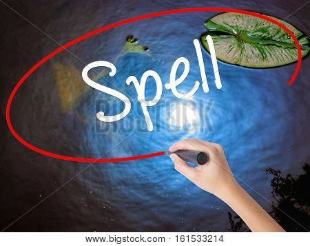 Woman Hand Writing Spell With Marker Over Transparent Board