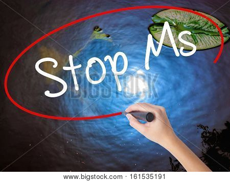 Woman Hand Writing Stop Ms With Marker Over Transparent Board
