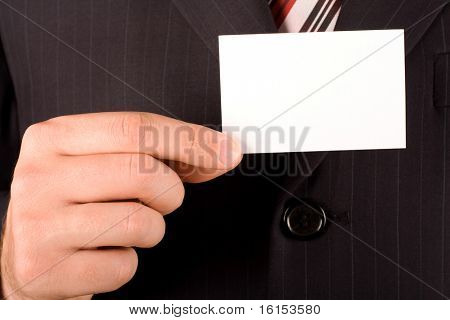 Business man holding blank business card